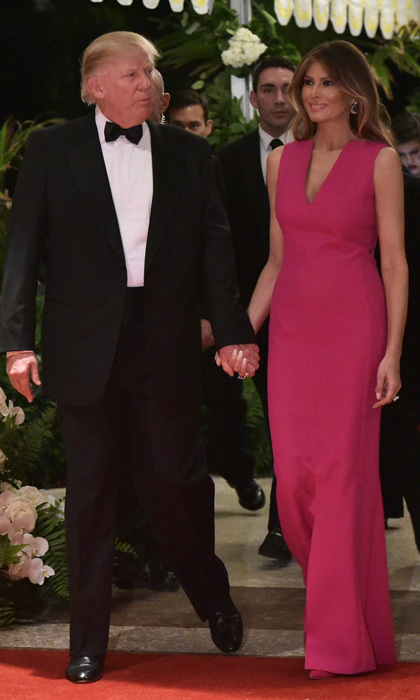 The first lady donned a full-length, vibrant gown by Christian Dior, which she accessorised with emerald and diamond jewels for the 60th annual Red Cross Gala at the Trump's Mar-a-Lago estate in Palm Beach.