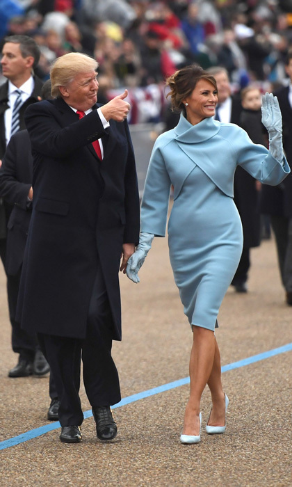 <p>For her debut as the nation's first lady, Melania channelled former first lady Jackie Kennedy. Barron Trump's mother's Inauguration Day outfit was a hint of the simple and chic silhouettes to come: a Ralph Lauren doubleface jacket that featured a collar cutaway and matching mock-turtle dress.</p><p>Photo: JIM WATSON/AFP/Getty Images</p>