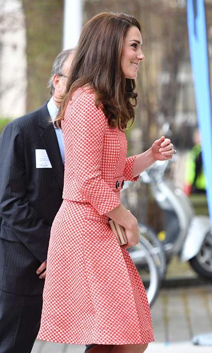 The Duchess of Cambridge wore this Eponine skirt suit and L.K. Bennett clutch bag.