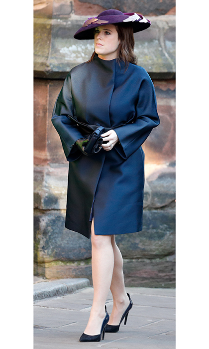 The royal wrapped up in a chic navy coat to attend  a service of thanksgiving in honour of the Queen's 90th birthday on June 10, 2016. She paired the belted coat with an over-size purple feathery hat.  