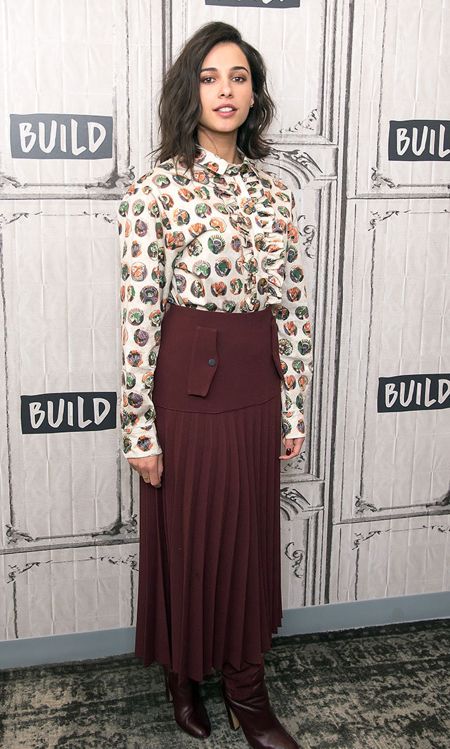<em>Power Rangers </em> star Naomi Scott looked fresh and chic in a playfully printed Burberry blouse, pleated Dion Lee skirt and burgundy Rebecca Bjornsdotter boots in New York. <p>Photo: © Getty Images </p>