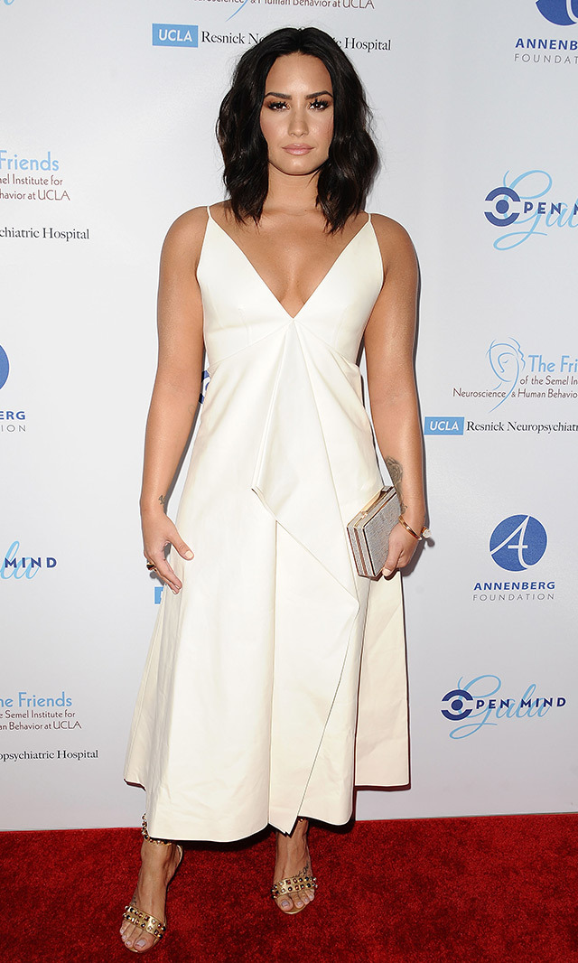 Demi Lovato embodied minimalist-chic in a white Valentino gown at UCLA's Semel Institute Biannual Open Mind Gala.<p> Photo: © Getty Images </p>