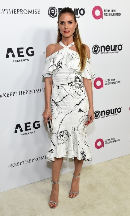 Heidi Klum looked chic in a black and white ensemble with popping red lipstick. Photo: Michael Kovac/Getty Images