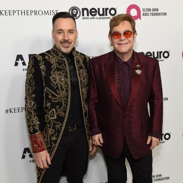 Happy birthday, Elton John! Elton and his husband, David Furnish, celebrated the legend's 70th Birthday and 50-Year songwriting partnership with Bernie Taupin on Saturday evening with a gala. The night benefited the Elton John AIDS Foundation and the UCLA Hammer Museum. Taking place at RED Studios in Hollywood, the bash was star-studded.