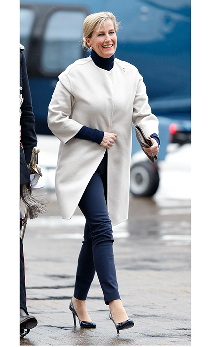 Sophie, Countess Of Wessex wore skinny navy pants and heels for her rain-soaked visit to the Orbis Flying Eye Hospital at Stansted Airport in London.