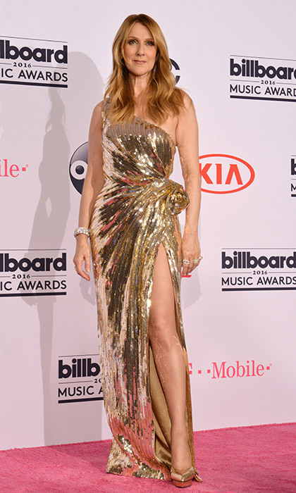 "Clad in a show-stopping gold lamé Versace gown, the French-Canadian singer belted out ""The Show Must Go On"" at the 2017 Billboard Music Awards before being presented with the Icon award by her son René Charles.