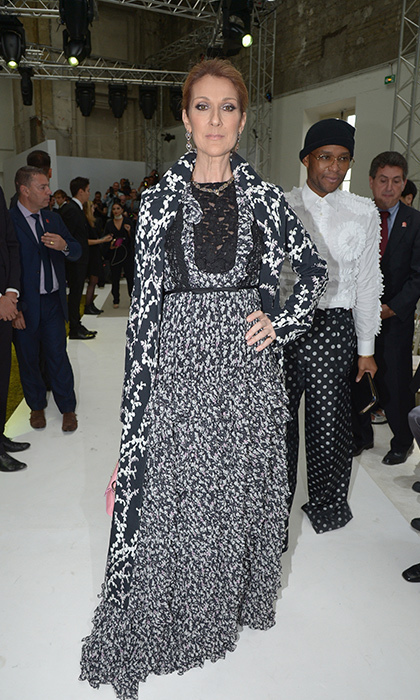 Gracing the front row at Giambattista Valli's couture presentation in Paris wearing a floral coat and lace-embellished dress by the designer. 