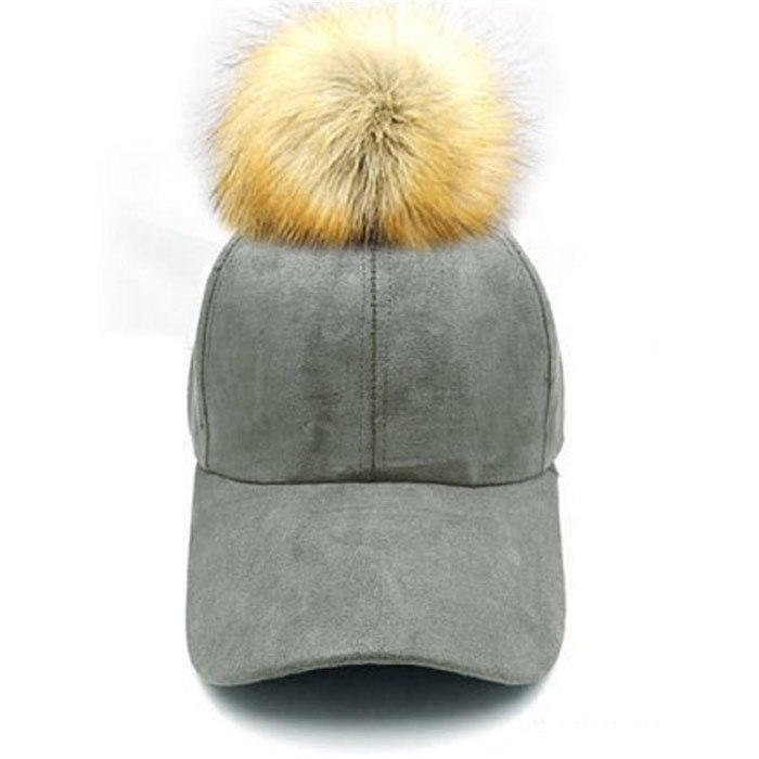 <p>Suede Pom Pom Hat in Grey, $32, <em>chapters.indigo.ca</em></p>