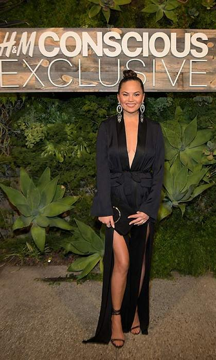 <strong>Mar. 28:</strong>Chrissy Teigen wore a black gown with a dramatic thigh high split and plunging neckline to the launch of the H&M Conscious collection. 