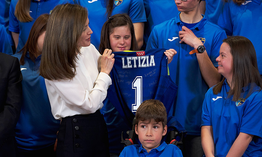 Queen Letizia of Spain received this cool personalized gift from youngsters from the Club Estudiantes SAD Foundation at the Zarzuela Palace on Mar. 28 in Madrid.