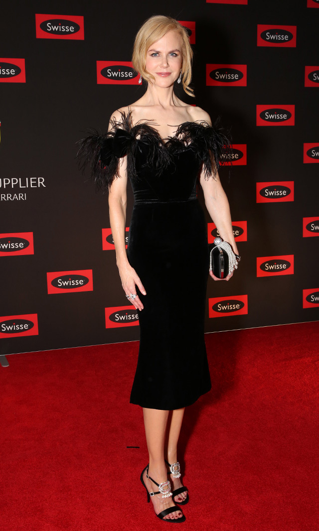 "Nicole Kidman goes for high drama in this black velvet Marchesa dress with feather detail and Roger Vivier crystal-buckle pearl-embellished satin sandals at the Swisse Wellness ""Power Your Passion"" event in Melbourne.<p>Photo: © Getty Images</p>"