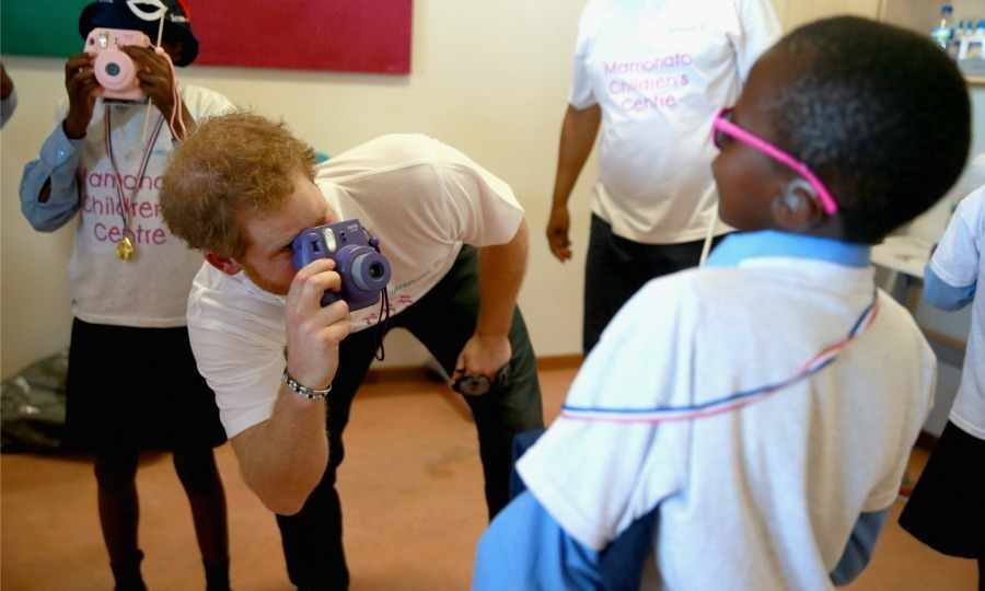 Say cheese! Harry played photographer with a cool kid during his visit to the Mamohato Children's Centre in Lesotho in 2015.