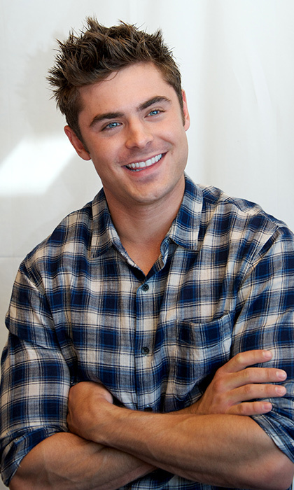 Zac Efron has revealed he was saved from a burning building by Hugh Jackman.