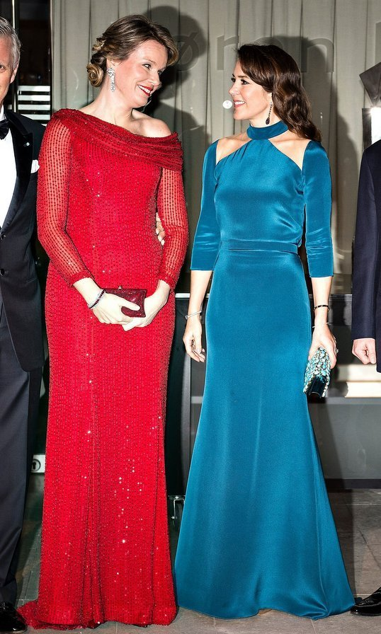 Crown Princess Mary of Denmark, right, and Queen Mathilde of Belgium both wore bright-hued gowns for a black tie gala in Copenhagen on March 29.