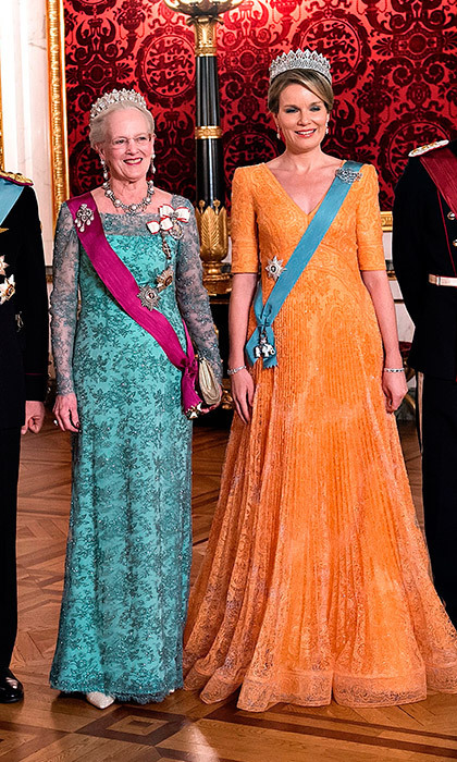 Queen Margrethe of Denmark, left, and Queen Mathilde of Belgium both opted for bold hues for the state dinner in honour of the Belgian royals on March 28 at Christiansborg Castle in Copenhagen.