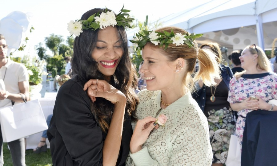 <h4>Apr. 1:</h4> Zoe Saldana and Kate Mara also had a blast at Victoria Beckham's party, dawning flower headbands at one point. The <em>Guardians of the Galaxy</em> star looked simple in a black ensemble, while Kate was spring-fresh in a mint green romper and stunning Tiffany necklace.