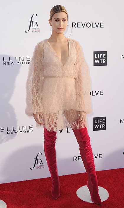 <h4>Apr. 2:</h4> Hailey Baldwin donned velvet thigh-high boots for the Daily Front Row's 3rd Annual Fashion Los Angeles Awards at the Sunset Tower Hotel.