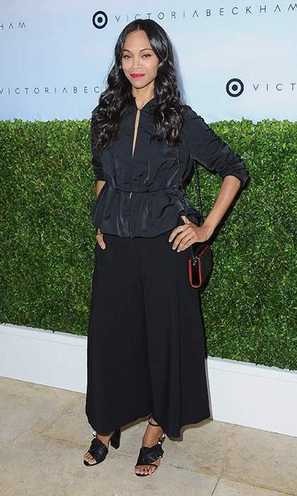 <h4>Apr. 1:</h4> New mom Zoe Saldana looked chic in this black blouse and wide leg cullottes styled with strappy sandals. Loose waves and a pop of red lipstick completed the look.