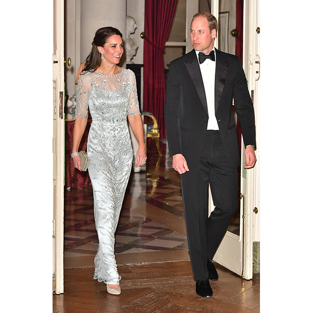 During her first visit to Paris as a senior royal in 2017, Kate made a sartorial splash in an eye-catching floor-length gown by Jenny Packham. Kate perfectly accessorized the dress's delicate crystallized overlay with a pair of diamond earrings and bracelet on loan from the Queen. 