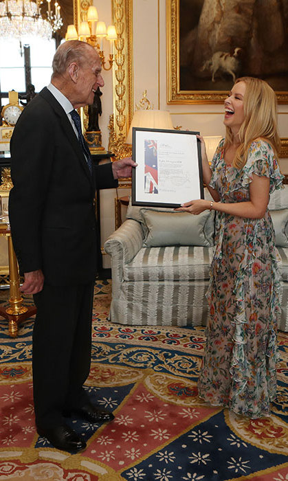 Kylie Minogue shares a giggle with Prince Philip. 