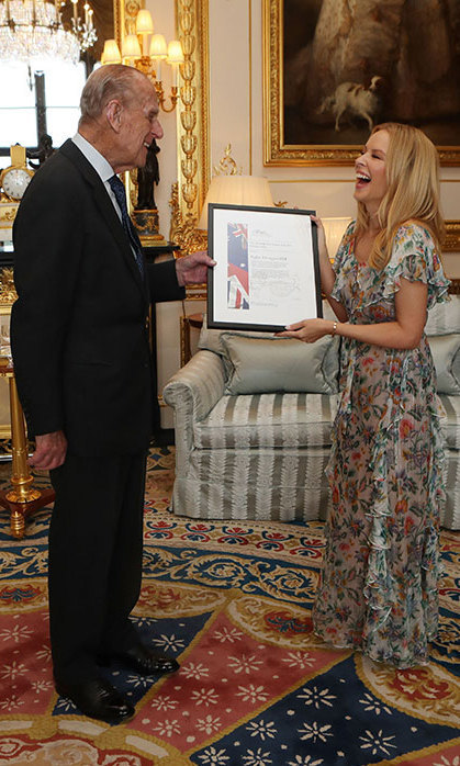 "Have a laugh! Prince Phillip presented Kylie Minogue with the Britain-Australia society award during her visit to Windsor Castle on April 4, 2017. The Spinning Around singer spoke about the honour saying, ""I am delighted to accept this award from the Britain-Australia Society. I'm a proud 'Aussie' but Britain has a very strong place in my heart having lived and worked here for many years. The Society does a wonderful job to promote the rich cultural ties between the two countries and I am honoured to be recognized by them in this way.""