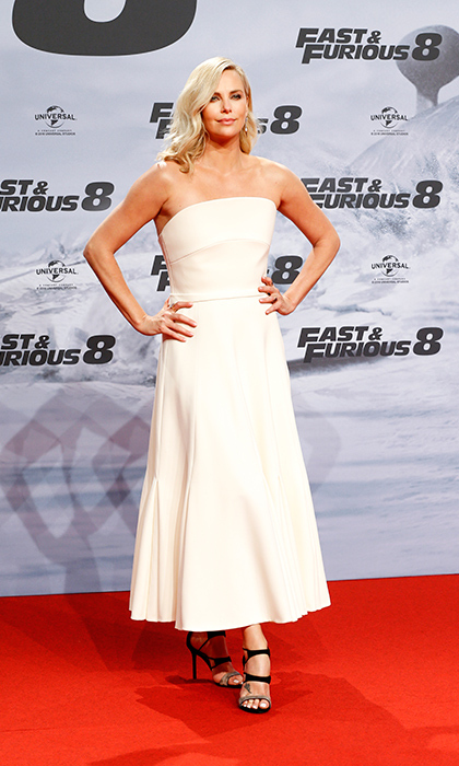 <h4>Apr. 4:</h4> Charlize Theron was a vision in white Christian Dior couture at the Berlin premiere of <em>Fast & Furious 8</em>.