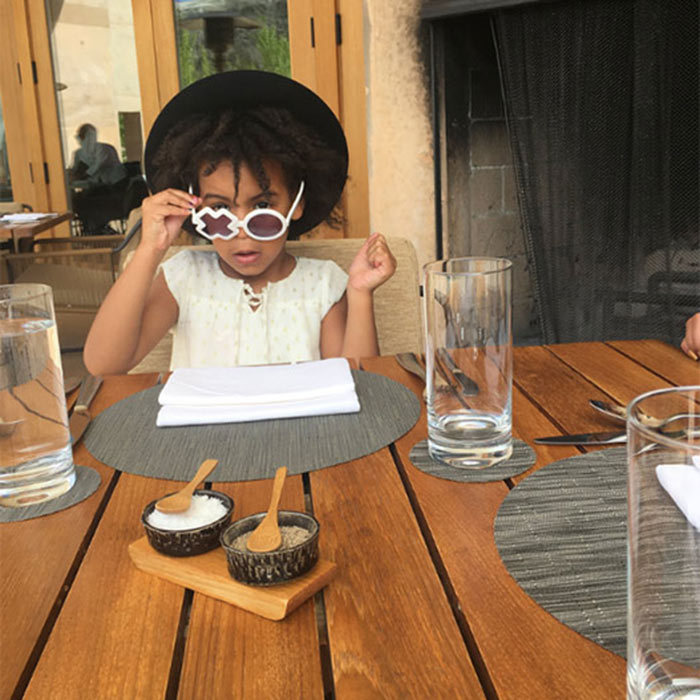 Blue Ivy stole the show in a cool pair of Sons and Daughters XO sunglasses and hat as she joined her parents for an al fresco meal.