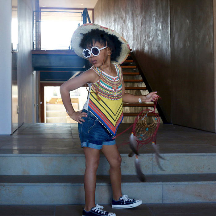 Just like her famous mum, Blue Ivy knows how to work the camera! The youngster struck her best pose for the camera, pouting with one hand on her hip for a fun holiday photo.
