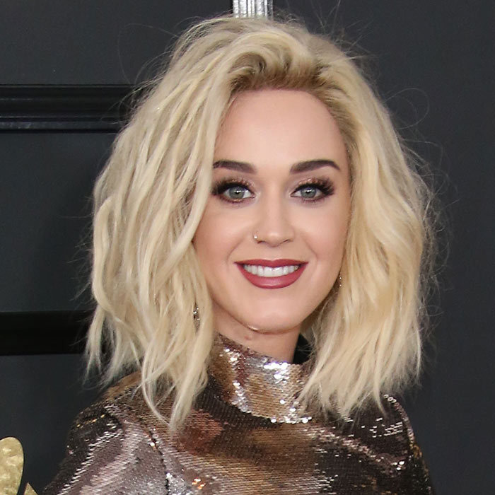 <h2><strong>Tousled lob</strong></h2><p>Intentionally messy hair has its red carpet moment every award season, and Katy Perry's sexy bed head for this year's GRAMMYs was a star example. The key to keeping a tousled lob on the classy side is a razor sharp fresh cut that gives intense volume some edge. </p><p>Photo: © Getty Images</p>