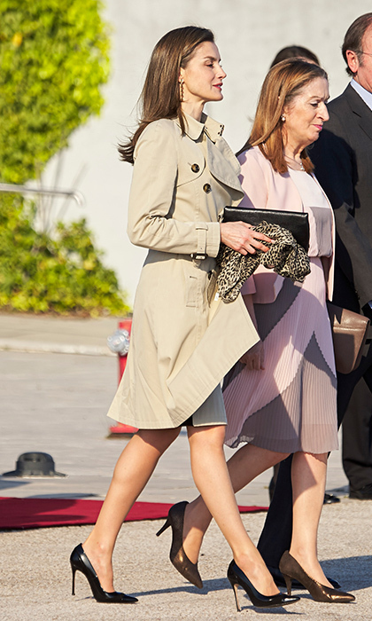 Queen Letizia of Spain kept airport style simple with a classic trench coat and black heels as she headed to Japan. 