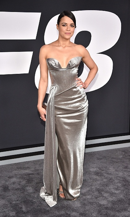 <h4>Apr. 8:</h4> Michelle Rodriguez coordinated with the grey carpet in a sexy silver gown by Vivienne Westwood.