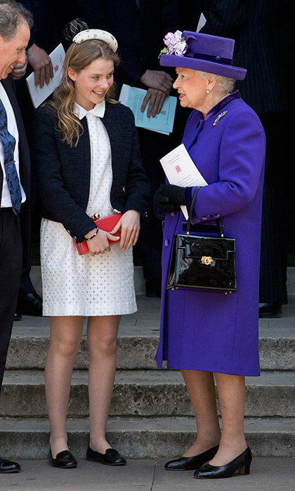 The Queen showed she's a fan of regal purple as she chatted with great-niece Lady Margarita Armstrong-Jones, who served as flower girl at Prince William and Duchess Kate's wedding in 2011. The 14-year-old royal looked very ladylike herself in an eyelet lace dress and flats.