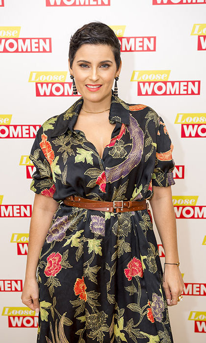 Nelly Furtado reveals split from partner, says she is ready to date.