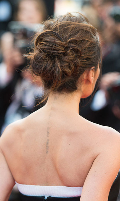 "<p><strong>Victoria's fading design</strong></p><p>Victoria has been seen removing her tattoos in recent years, reportedly not wishing to grow old with them. Her Hebrew tattoo down the side of her back matches David's, both meaning ""I am my beloved and my beloved is mine.""</p><p>Photo: &copy; Getty Images</p>"