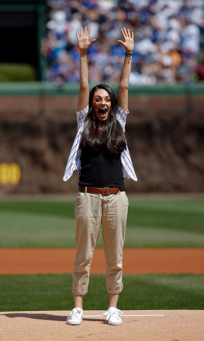 <h4>Apr. 15:</h4>Strike! Mila Kunis celebrates after throwing out the ceremonial first pitch before the Cubs vs. Pirates game at Wrigley Field. 