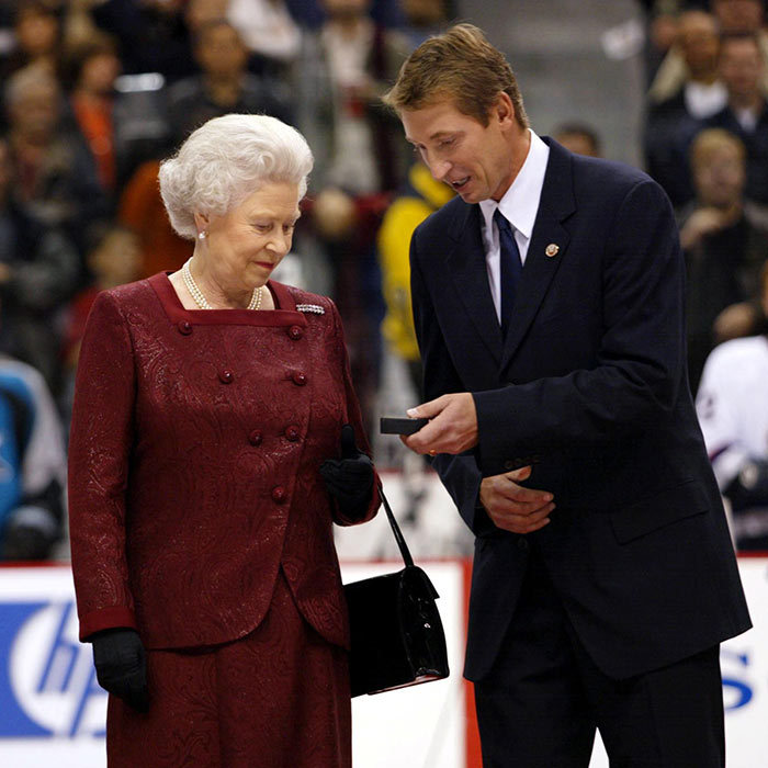 <h3>HER VERY OWN HOCKEY PUCK</h3><p>During her Golden Jubilee visit to B.C. in 2002, the Queen performed the ceremonial puck drop, accompanied by Canadian NHL legend Wayne Gretzky, at the start of the game between the Vancouver Canucks and San Jose Sharks – players banged their sticks on the ice as a traditional hockey salute to the monarch. Her Majesty was then presented with the puck as a souvenir.</p><p>Photo: © Getty Images</p>