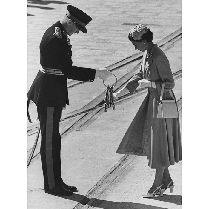 <h3>KEYS TO A FORTRESS</h3><p>For the woman who has everything! The Queen symbolically accepts the traditional gift of four silver keys of the fortress of Gibraltar from Gov.-Gen. Sir Gordon MacMillan during her visit in 1954 – a politically charged time due to territorial conflict between Britain and Spain. </p><p>Photo: © Getty Images</p>