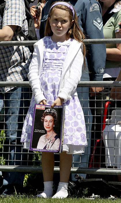 <h3>A COPY OF THE FINEST MAGAZINE</h3><p>A young fan holds a copy of <em>Hello! Canada</em>'s special royal commemorative edition as she waits outside St. James Cathedral for the Queen to exit Sunday service during Her Majesty's visit to Toronto in 2010. The Queen was wrapping up the final stop of a nine-day tour of Canada with Prince Philip, including Canada Day festivities on Parliament Hill.</p><p>Photo: © Getty Images</p>