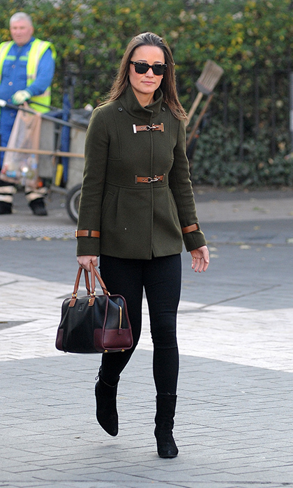 Oh-so-chic, Pippa styled her black skinnies and black boots with an olive military-inspired coat with brown toggles.