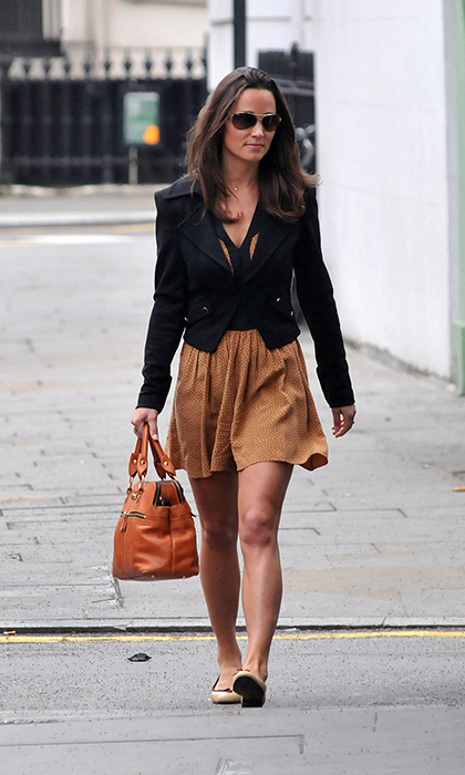 Ever the street style pro, Pippa rocked a neutral tan and black dress and blazer look, which she expertly accessorised with a tan handbag and nude flats.