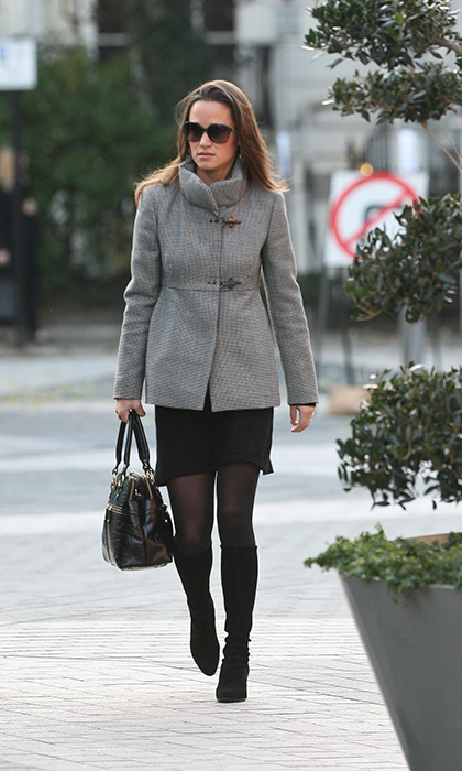 Kate's younger sister stayed neutral with a grey coat over her otherwise all-black ensemble.