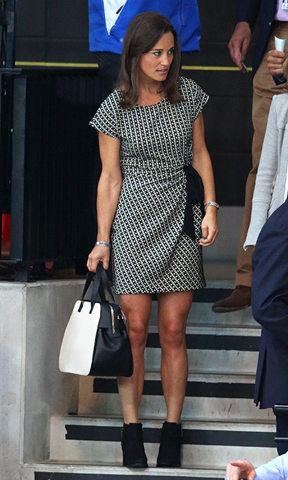 Pippa went monochromatic with a black and white patterned dress, black booties, and colour-blocked handbag.