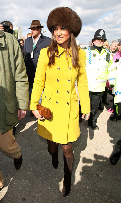Pippa looked warm and stylish in a banana-yellow coat and fur hat.