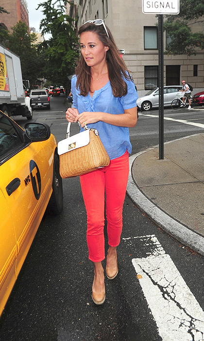 Pippa opted for a bright look, wearing coral cropped pants with a blue blouse, nude espadrilles and her wicker handbag.