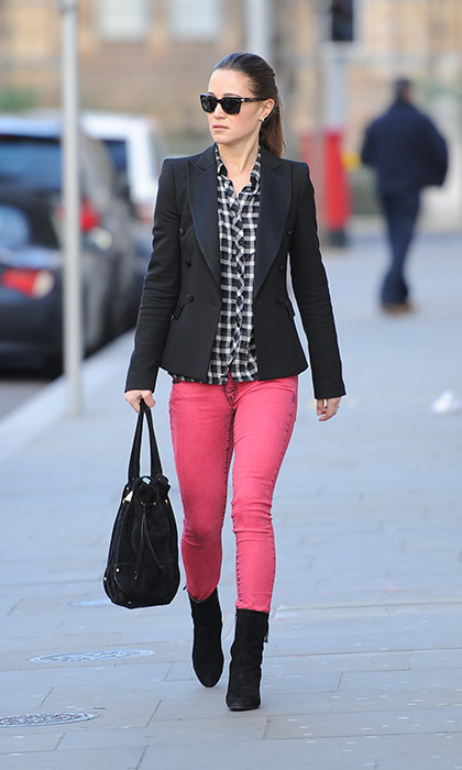 Not one to shy away from colour on occasion, Pippa chose a pair of bright pink pants with a gingham blouse and navy jacket.