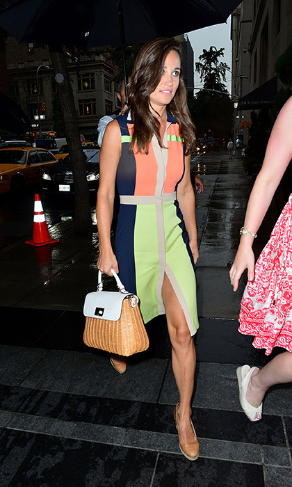 A bright colour-blocked dress with lime green and orange panels with her go-anywhere purse.