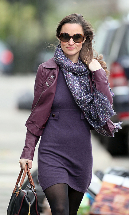 Pippa kept oh-so-cosy in a purple knit dress with matching leather jack and purple printed scarf.