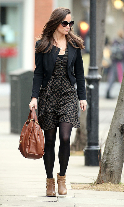 Pippa kept it simple in a tan and black print dress, black blazer, tan ankle boots and brown bag.