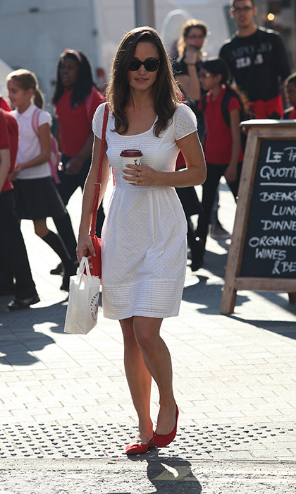 While grabbing coffee to-go, Pippa walked the streets of London in a darling white sundress and red flats.
