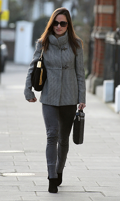 Pippa bundled up and paired her gray skinnies with a grey coat for a cool monochromatic look.
